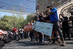 Hawk Lawshe receives $5,000 and a trip to the Mooneyes Show in Japan for his first place win on stage at the Born Free chopper show. Silverado, CA. USA. Saturday June 23, 2018. Photography ©2018 Michael Lichter.