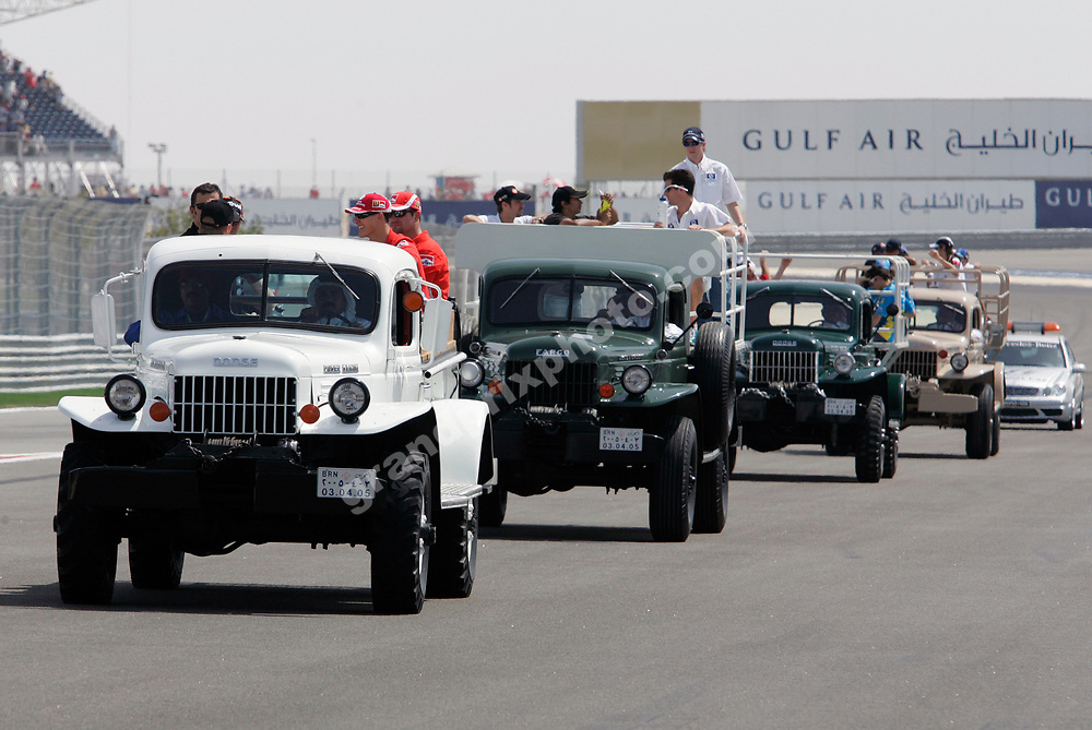 The drivers parade before the 2005 Bahrain Grand Prix saw all the F1 drivers on old trucks. Photo: Grand Prix Photo