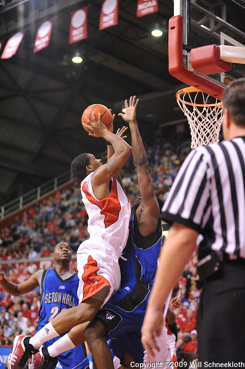 Feb 8, 2009; Piscataway, NJ, USA; Rutgers guard Anthony Farmer (2) puts up a basket against Seton Hall forward Mike Davis (13) during the first half of Seton Hall's 65-60 victory at the Louis Brown Athletic Center.