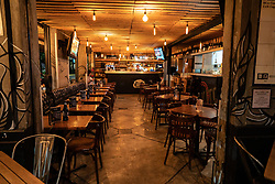 Mexico City, Mexico, 26 March 2020, an empty restaurant in the busy area of Condessa in Mexico City. Residents have been told to stay at home. Restaurants are recommended to close, however, some remain open.