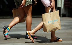 Embargoed to 0001 Tuesday August 1 File photo dated 16/07/13 of shoppers in central London. Consumer confidence regained its poise in July after suffering a slowdown in the wake of Theresa May's shock General Election result.
