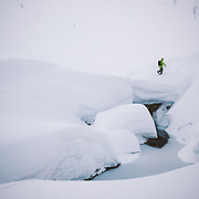 Tyler Hatcher skins up for another run in the Cascade backcountry during a winter storm.