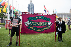 London, UK. 24th July, 2021. Protesters stand alongside an Equity banner in Parliament Square before the first-ever Reclaim Pride march. Reclaim Pride replaced the traditional Pride in London march, which many feel has become too commercial and strayed from its roots in protest, and was billed as a People's Pride march for LGBTI+ liberation.