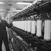 Industrial Yarns Bray..1963..23.08.1963..08.23.1963..23rd August 1963...Image shows Mr P Bancart of ICI Export Ltd pointing out some of the intricacies of a loom at the Industrial Yarns factory in Bray, Co Wicklow
