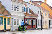 Visitors strolling in the old town in Odense on Funen Island, Denmark