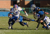 Interlakes Nick Brothers gets past Winnisquam's Christian Serrano during NHIAA Semi Final football with Winnisquam on Saturday afternoon.  (Karen Bobotas/for the Laconia Daily Sun)