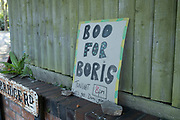 Sign in Moseley asking local people to join in with a Boo for Boris in an attempt to show displeasure at Boris Johnsons chief political advisor Dominic Cummins remaining in his post after allegedly breaking the Coronavirus lockdown rules on 26th May 2020 in Birmingham, England, United Kingdom. Coronavirus or Covid-19 is a new respiratory illness that has not previously been seen in humans. While much or Europe has been placed into lockdown, the UK government has put in place more stringent rules as part of their long term strategy, and in particular social distancing.