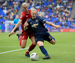 Liverpool Women's Leandra Little (Left) and Manchester United Women's Leah Galton battle for the ball during the Continental Tyres Cup, Group Two North match at Prenton Park, Birkenhead.