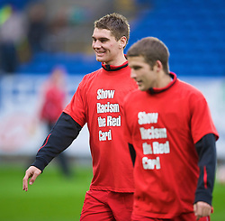 CARDIFF, WALES - Saturday, November 14, 2009: Wales' Sam Vokes warms-up wearing a 'Show Racism the Red Card' shirt before the international friendly match against Scotland at the Cardiff City Stadium. (Pic by David Rawcliffe/Propaganda)