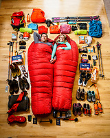 Rob Lea and Caroline Gleich lay among their gear for Everest.