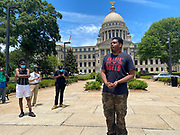 "Today at the Mississippi State Capitol 29 yr old history teacher from Cardozo Middle School ,Dhahran Hall, spoke truth to power and lead  demonstrators in support of Black Lives Matter and the murder of George Floyd and police brutality and systematic racism. Protestors gathered at the State Capitol and marched around downtown Jackson returning to the Capitol they chanted "" Say There Names"", "" I can't Breathe"", "" No Justice No Peace"" "" Justice for George Floyd"" it was a very peaceful protest and march.  In the past 6 days protests and riots have broken out across America in response to the brutal killing of an unarmed African American man by the knee and hands of Minnesota Police<br />