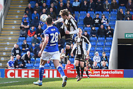 Notts County defender Elliott Hewitt (4) heads towards goal during the EFL Sky Bet League 2 match between Chesterfield and Notts County at the b2net stadium, Chesterfield, England on 25 March 2018. Picture by Jon Hobley.