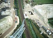 Nederland, Barendrecht, havenspoorlijn, 17-10-2001; luchtfoto van de aanleg Betuweroute, het zand (links en rechts van de goederenspoorlijn) vormt het talud voor het toekomstig viaduct van de Betuwelijn; zand voor viaduct moet inklinken; pijlers reeds zichtbaar; hoogspranningsmast landschap infrastructuur.<br /> luchtfoto (toeslag), aerial photo (additional fee)<br /> photo/foto Siebe Swart