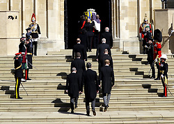 The Duke of Edinburgh's coffin, covered with His Royal Highness's Personal Standard is carried into St George's Chapel, Windsor Castle, Berkshire, followed by the Prince of Wales, the Princess Royal, the Earl of Wessex, the Duke of York, the Duke of Cambridge, the Duke of Sussex, the Earl of Snowdon and Vice-Admiral Sir Timothy Laurence during the funeral of the Duke of Edinburgh. Picture date: Saturday April 17, 2021.