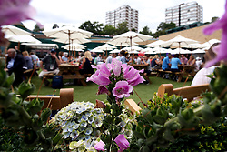 A bee flies near flowers next to the new food court replacing the old court Nineteen on day two of the Wimbledon Championships at The All England Lawn Tennis and Croquet Club, Wimbledon.