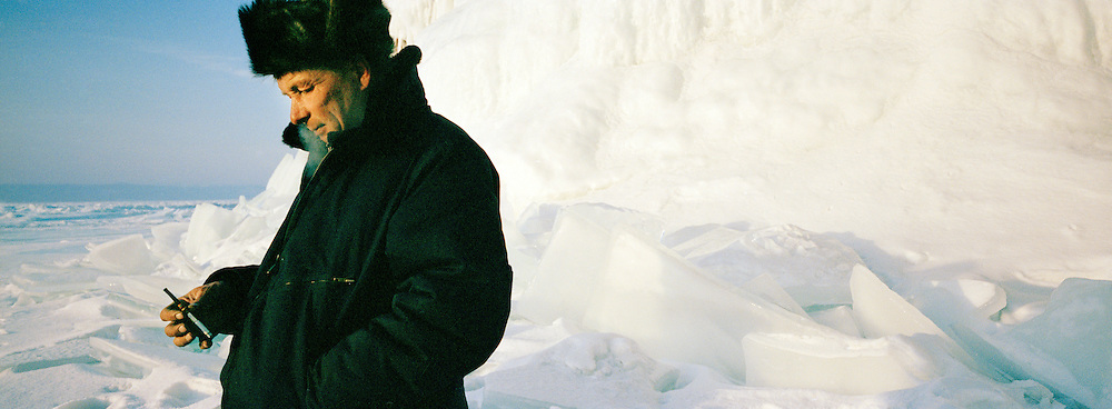 Local man with cigarette on the frozen Lake Baikal, Siberia, Russia