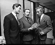Eurovision Song Contest Announcement..1971..17.02.1971..02.17.1971..17th February 1971..Pictured at the press conference to announce the forthcoming Eurovision Song Contest in April were:.Mr Jack White, Assistant Controller of programmes, RTE, Mr Alpho O'Reilly,Art Director,Eurovision Song Contest and Mr Michael Garvy, Controller of Programmes,RTE..They were pictured viewing the Crystal Trophy which will be awarded to the competition winners.