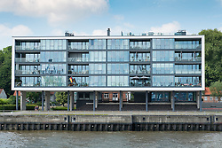 Modern luxury apartment building on waterfront of River Elbe in Hamburg Germany