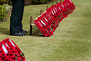 Wreaths of poppies that will be laid by dignitaries during the Remembrance Sunday ceremony at the Hodogaya, Commonwealth War Graves Cemetery in Hodogaya, Yokohama, Kanagawa, Japan. Sunday November 12th 2017. The Hodagaya Cemetery holds the remains of more than 1500 servicemen and women, from the Commonwealth but also from Holland and the United States, who died as prisoners of war or during the Allied occupation of Japan. Each year officials from the British and Commonwealth embassies, the British Legion and the British Chamber of Commerce honour the dead at a ceremony in this beautiful cemetery.