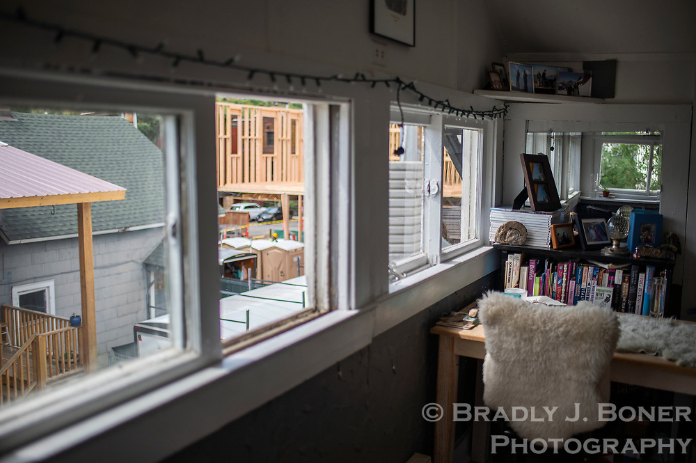 The small living room in Brigid Mander's upstairs apartment in one of the old St. John's Hospital nurses quarters, with a view of the luxury condominiums being constructed next door.