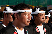 Faces of Danjiri pullers during the Kishiwada Danjiri matsuri in Kishiwada, Osaka, Japan. Sunday, September 20th 2009. Ornately carved floats called Danjiri are pulled through the streets of Kishiwada during the danjiri festival or matsuri. Each float weigh about 4 tonnes and stands over 3 metres high. They are pulled by teams of up to a thousand people, young and old, and each challenges itself to skid the danjiri round street corners at great speed.