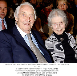 SIR NICHOLAS & LADY HENDERSON at a lectrure in London on 13th May 2002.OZX 71