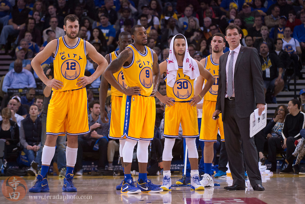 November 17, 2015; Oakland, CA, USA; Golden State Warriors interim head coach Luke Walton (far right) stands with his team during the fourth quarter against the Toronto Raptors at Oracle Arena. The Warriors defeated the Raptors 115-110.
