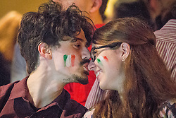 © Licensed to London News Pictures . 14/06/2014 .  Manchester , UK . A man kisses a woman on the nose . Football fans in Walkabout in Manchester City Centre this evening (Saturday 14th June 2014) as England play Italy in their first match of the 2014 World Cup , in Brazil . Photo credit : Joel Goodman/LNP