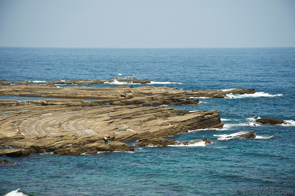 Fishermen take advantage of the unusual seaside rock formations on the east coast of Taiwan.