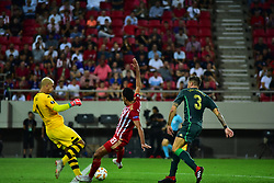 September 20, 2018 - Piraeus, Attiki, Greece - Ahmed Hassan (no 18) of Olympiacos attempt to score under the pressure of both players of Real Betis, Joel Robles (no 1) goalkeeper and Javi Garcia (no 3) (Credit Image: © Dimitrios Karvountzis/Pacific Press via ZUMA Wire)
