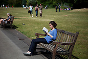 A woman reads her book in Queen Mary's Gardens in Regents Park in the Inner Circle. It is one of those secret special places in London where people come to relax.