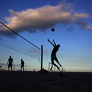 Locals play foot volley, a hybrid game combining beach volley ball and football at Copacabana beach, Rio de Janeiro,  Brazil. 5th July 2010. Photo Tim Clayton..