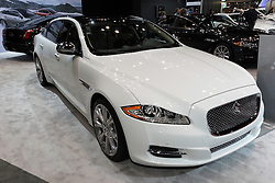 08  February 2013: 2013 Jaguar XJL Portfolio AWD. Chicago Auto Show, Chicago Automobile Trade Association (CATA), McCormick Place, Chicago Illinois<br /> <br /> 2013 JAGUAR XJ: Jaguar describes the XJ as passion in motion; a dramatic combination of beauty, refinement and sheer exhilarating power. In other words, a premium luxury sedan with cat-like agility. Outside, the sweep of its streamlined roof over the four-door body has a sleek, coupe-like profile, and employs lightweight aluminum construction. For 2013, the XJ lineup includes seven model choices: XJ, XJ AWD, XJL Portfolio, XJL Portfolio AWD, XJ and XJL Supercharged, XJ and XJL Supersport, and top-tier XJ Ultimate. Depending on trim level, there are three engines offered, all nicely mated to eight-speed automatic transmissions. The 3.0 liter V-6 is supercharged and develops a healthy 340 horsepower. Then there are three versions of the 5.0L V-8, with the natural aspirated at 385hp and the supercharged versions belting out 470 and 510 hp. The top speed is 155 mph and the XJ can accelerate from 0-to-60 mph in 4.7 seconds. Inside the six-occupant cabin, XJ offers a range of leather grains, a choice of premium wooden veneers and carbon-fiber finishes tailored to personal taste. Passengers have an exceptional view with a panoramic, heat-reflective glass roof that extends to the full width of the car and sweeps as far back as the rear seat area. The latest XJs smoothly transports 18.4 cu. ft. of luggage in the tailored trunk. A variety of stunning 19- and 20-inch alloy wheels are available, with wider wheels fitted at the rear of the car, optimizing grip and enhancing the car's sporting, athletic stance.