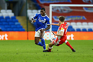 Cardiff City's Sheyi Ojo (27) is tackled by Millwalls's Maikel Kieftenbeld (16) during the EFL Sky Bet Championship match between Cardiff City and Millwall at the Cardiff City Stadium, Cardiff, Wales on 30 January 2021.