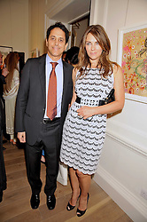 DR JAMSHID GHAJAR and LIZ HURLEY at a party to launch the Indian Head Injury Foundation held at Thomas Gibson Fine Art Ltd. 31 Bruton Street, London on 16th June 2009