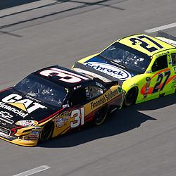 April 17, 2011; Talladega, AL, USA; NASCAR Sprint Cup Series driver Paul Menard (27) drafts Jeff Burton (31) during the Aarons 499 at Talladega Superspeedway.   Mandatory Credit: Derick E. Hingle