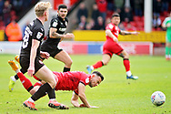 Barnsley defender Ben Williams (28) fouls Walsall FC midfielder Zeli Ismail (10) during the EFL Sky Bet League 1 match between Walsall and Barnsley at the Banks's Stadium, Walsall, England on 23 March 2019.