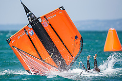 Moth dingy capsizes and the helmsman, Scott Cotton falls in the water in spectaculair style.<br /> <br /> Day 2 of the McDougall + McConaghy 2015 Moth Worlds, Sailing Anarchy and Sperry Top-Sider Moth Worlds coverage 2015, Sorrento, Australia. January 11th 2015. Photo © Sander van der Borch.
