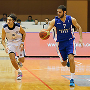 Istanbul BSB's Sasha Vujacic (L) and Anadolu Efes's Stratos Perperoglou (R) during their Turkish Basketball League match Istanbul BSB between Anadolu Efes at Cebeci Arena in Istanbul Turkey on Monday 09 March 2015. Photo by Aykut AKICI/TURKPIX