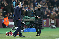 Jose Mourinho, the Manchester United manager talking to Slaven Bilic, the West Ham United manager from the touchline. Premier league match, West Ham Utd v Manchester Utd at the London Stadium, Queen Elizabeth Olympic Park in London on Monday 2nd January 2017.<br /> pic by John Patrick Fletcher, Andrew Orchard sports photography.