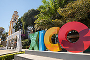 Decorative letters spell out the town name with the Parroquia Santa María Magdalena church in Xico Park in Xico, Veracruz, Mexico.