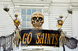 30 October 2015. New Orleans, Louisiana.<br /> The Skeleton Krewe mansion on St Charles Avenue at the corner of State Street draws crowds with its satirically spooky Halloween decorations. <br /> Photo©; Charlie Varley/varleypix.com