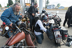 The California Cannonballers at a gas stop during Stage 14 - (284 miles) of the Motorcycle Cannonball Cross-Country Endurance Run, which on this day ran from Meridian to Lewiston, Idaho, USA. Friday, September 19, 2014.  Photography ©2014 Michael Lichter.