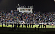 People watch the football game between Monroe-Woodbury and Newburgh Free Academy at Etzel Field in Central Valley on Friday, Sept. 20, 2013.