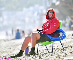 EXCLUSIVE: Adam Sandler spends time with his friends and family on the beach in Malibu. Adam was seen enjoying some food while hanging out with friends as he hung out on a lawn chair. He was seen wearing a pair of black shoes and socks. While out on the beach a group of friends also stopped by to say hello. 07 Jun 2020 Pictured: Adam Sandler. Photo credit: MEGA TheMegaAgency.com +1 888 505 6342