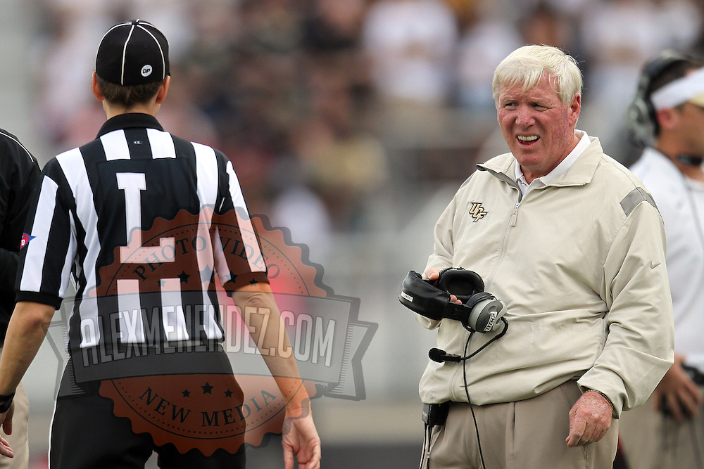 UCF Head Coach George O'Leary argues a call with Line Judge Sarah Thomas during an NCAA football game between the Memphis Tigers and the Central Florida Knights at Bright House Networks Stadium on Saturday, October 29, 2011 in Orlando, Florida. (AP Photo/Alex Menendez)