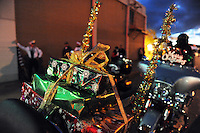 Motorcycles bearing presents wait for the start of the parade. Thousands of Salinas residents turned out on Sunday evening to experience the magic of the 14th annual Holiday Parade of Lights in Oldtown Salinas.