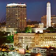 Downtown Kansas City's Liberty Memorial and Crown Center areas at dawn.