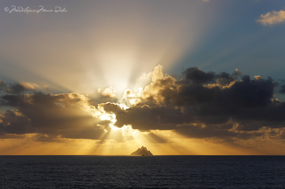 Sunset beams behind Skelligs, County Kerry, Ireland ****** <br /> <br /> Visit & browse through my Photography & Art Gallery, located on the Wild Atlantic Way & Skellig Ring between Waterville and Ballinskelligs (Skellig Coast R567), only 3 minutes from the main Ring of Kerry road.<br /> https://goo.gl/maps/syg6bd3KQtw<br /> <br /> ******<br /> <br /> Contact: 085 7803273 from an Irish mobile phone or +353 85 7803273 from an international mobile phone