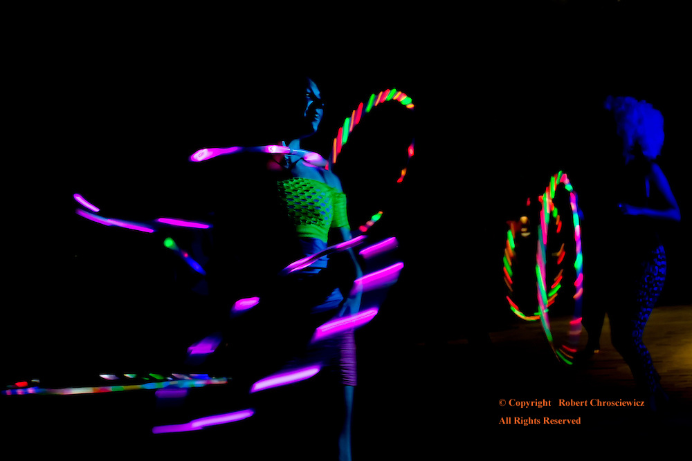 Night Moves: Young women dance the night away with LED hula hoops on the campus of the University of British Columbia, Vancouver British Columbia Canada.<br /> <br /> This was part of a night time celebration during the charity Radiant Run.